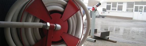 Hose reels and hose systems with lay-flat hose